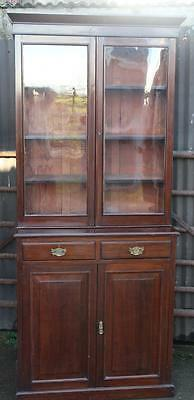 A Large Victorian Walnut Bookcase Cabinet raised over Cupboard Base