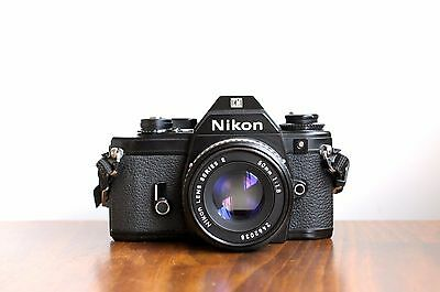 NIKON EM 35mm film camera   w/ Nikon 50mm f/1.8 Lens    *  Good/Read *