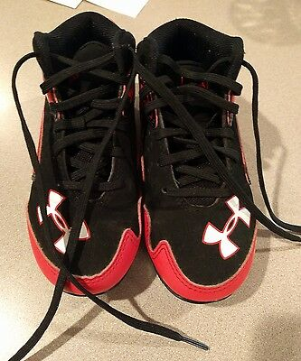 Under Armour red, black baseball cleats, toddler size 10