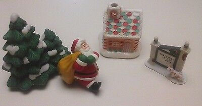 Lot Of 4 Christmas/holiday Figurines/decorations/santa/tree/gingerbread House