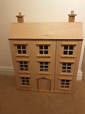 Wooden dolls house with all furniture and family