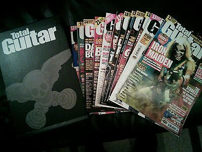 12 copies of Total Guitar magazine with CD's and storage box