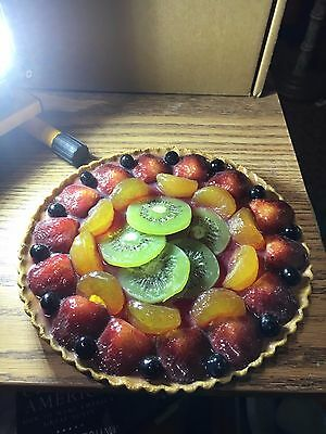 glazed pie with various fruits sculpture
