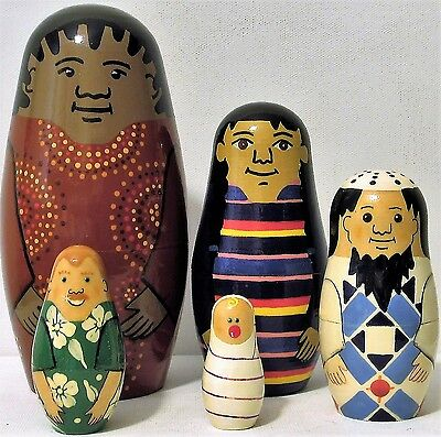 Russian  nesting dolls . made in russia and signed 5 piece and 7 inches tall