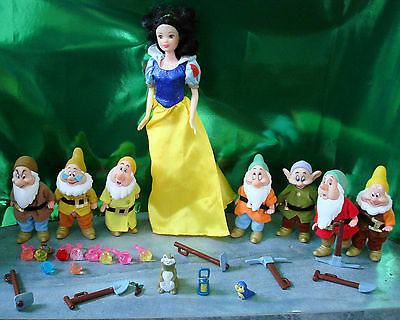 Disney Snow White and the Seven Dwarves doll and figures with accessories.
