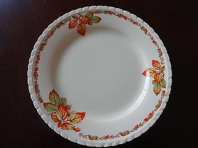 New Hall Pottery Round Plate with an Autumn Leaves Pattern - orange/yellow/green