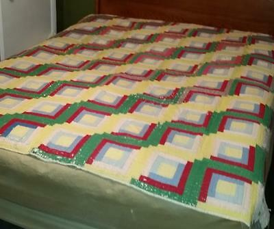 Old worn log cabin quilt colorful cotton fabric hand sewn quilted vintage cutter