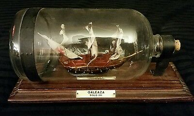"Vtg. Model Wood Sailing Ship in glass bottle/Galeaza Siglo XVI/on stand/9"" x 5"""