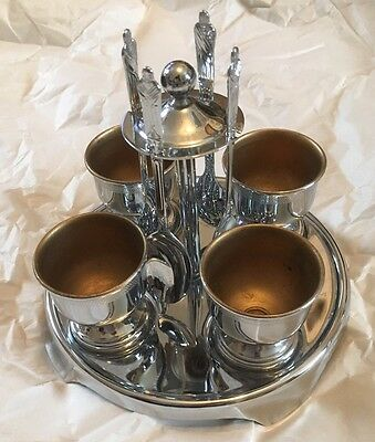 A fabulous Vintage Chrome Plated Egg Cup Stand, 4 Egg Cups and 4 Spoons Set