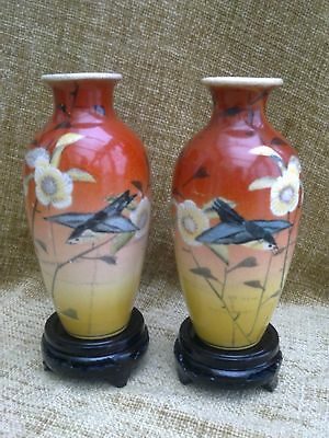 Japanese Antique Meiji Period Facing Pair Of Satsuma Vases On Carved Wood Stands