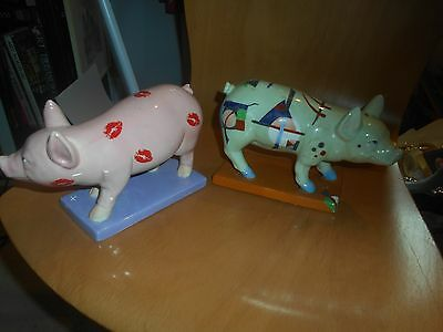 2 pottery party piggies, with minor knocks