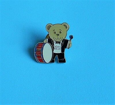 zoe's bear playing the drum stud pin badge charity