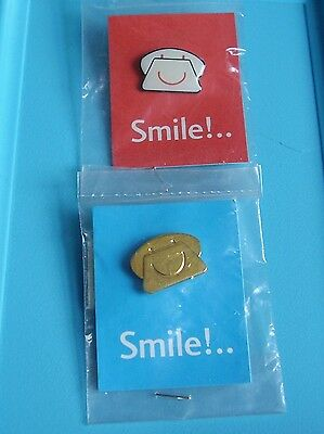 2 smile telephone stud pin badges charity