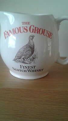 """A """"Famous Grouse"""" Scotch Whisky water jug"""