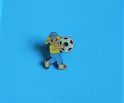 girl holding a football stud pin badge charity