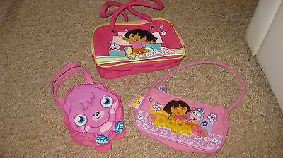 3 girls pink bags, 2 Dora the Explorer and 1 Moshi Monsters Poppet