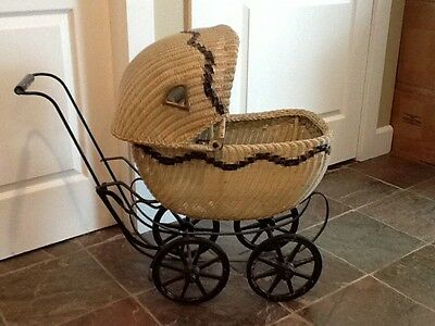 Antique wicker baby doll carriage stroller