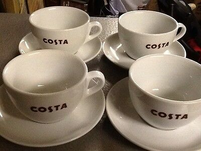 4 authentic medio COSTA coffee cups and saucers brand new