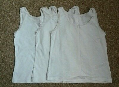 F&F girls pack of three vests. Size 6-7. 100% cotton. Lace trim.