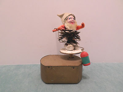 Antique Christmas Music Box Celluloid Elf on Gold Tone Metal Music Box
