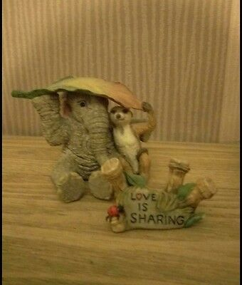 tuskers elephants love is...sharing (with meerkat)