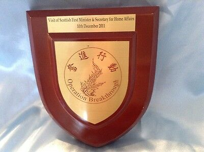 Wooden Plaque from Operation Breakthrough, gifted to M.S.P. Mr Alex Salmond