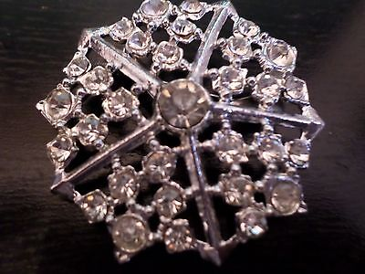 Vintage Silver Tone 1980 Brooch: Pierced and set with Sparkling Clear Crystals