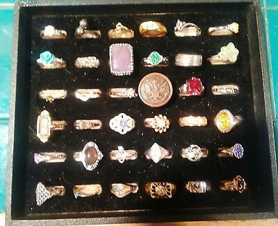Lot of  36 Costume rings and some that are sterling silver