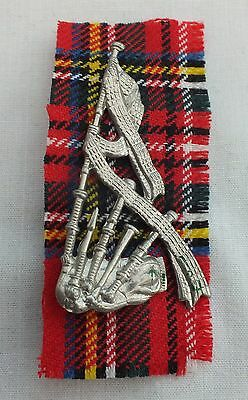 A Piper's Sleeve Badge.