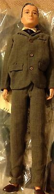 Dr.John Littlechamp  doll. In suit and has pajamas and bathrobe