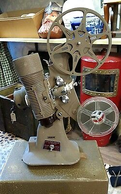 Vintage Working 8mm Bell & Howell 606 Movie Projector with case & film etc