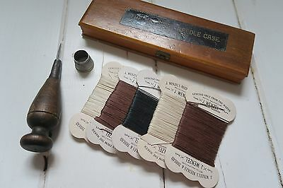 Vintage sewing items- threads, thimble, needle case