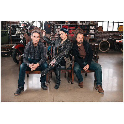 Danielle Colby-Cushing Seated with American Pickers in Garage 8 x 10 Inch Photo
