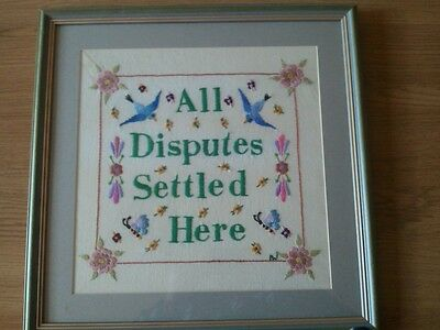 Contemporary embroidery sampler 'All disputes settled here'