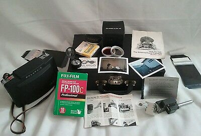 Polaroid Land Camera 180 w/Tominon 114mm f4.5 Lens. Tested & case. Made in Japan