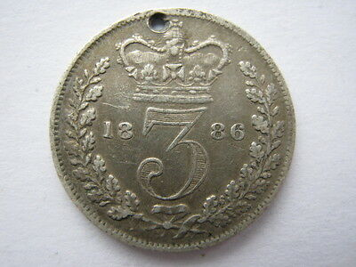 1886 Young Head silver Threepence VF holed