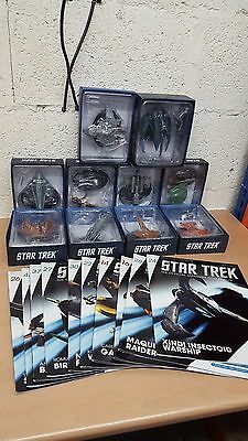 A Collection Of 10 Star Trek Figures And Magazines