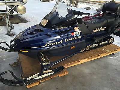 Pair of 1999 Ski-doo Grand Touring Snowmobiles with Trailer Low Miles