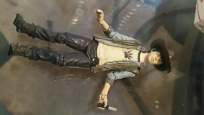 McFarlane Toys The Walking Dead Series 4: Carl Grimes Action Figure