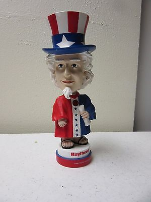 ^ Uncle Sam Bobble Head Doll by the Raytheon Corporation