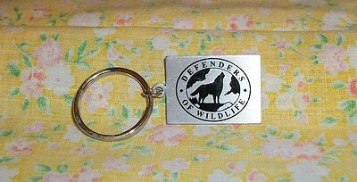 Defenders Of Wildlife Metal Key Ring Silver Color w/ Black Howling Wolf Image
