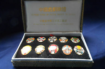 10 Chinese enamelled tie-clips/pins depicting opera masks