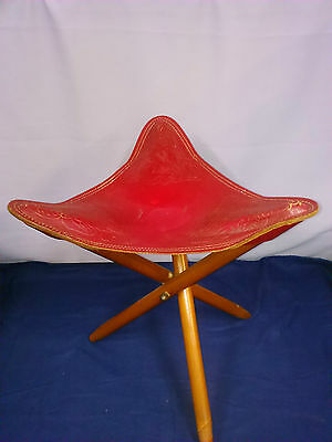 Vintage red leather tripod stool
