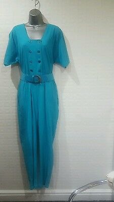 Turquoise jumpsuit sz 16/18 with free belt.