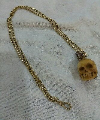 Antique watch gold chain fob with bone skull