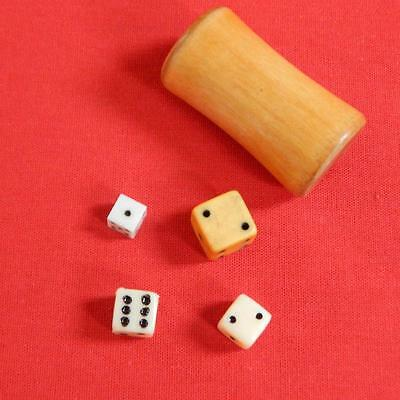 Vintage wooden Game dice shaker and mixed collection of dice.