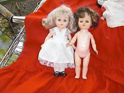 1 vogue dressed doll, 1 doll with markings