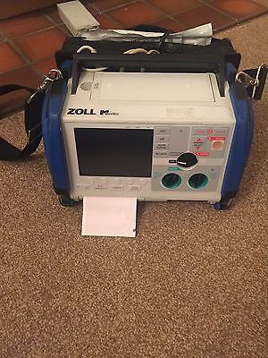 zoll m series with pads, dots, leads, battery and 4 bay charger