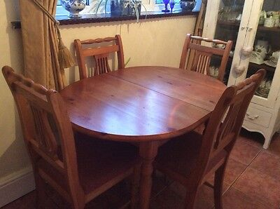 solid antique pine oval table and four chairs
