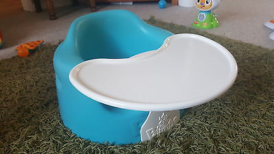 Blue Bumbo baby seat with tray